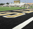Members of the Henrietta High School varsity football team take part in drills Friday on the new artificial turf field at Bearcat Stadium. The turf is part of a $3.06 million bond from the Texas Education Agency.