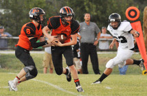 Petrolia's Jonathan Baker takes a handoff from quarterback Dane Williams in the second quarter of Friday's loss to Archer City.