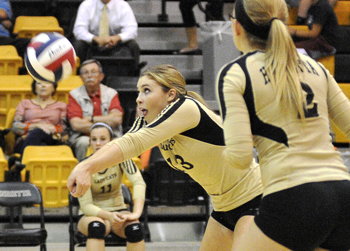 Henrietta's Addie McDonnell gets one of her six digs in the Lady Cats four-set win over Burkburnett Tuesday. Henrietta hosts Bowie to kick off district play Friday.