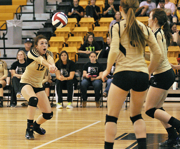Lady Cat Hollie Thomas keeps a volley alive Tuesday during the first set of Henrietta's sweep of Hirschi.