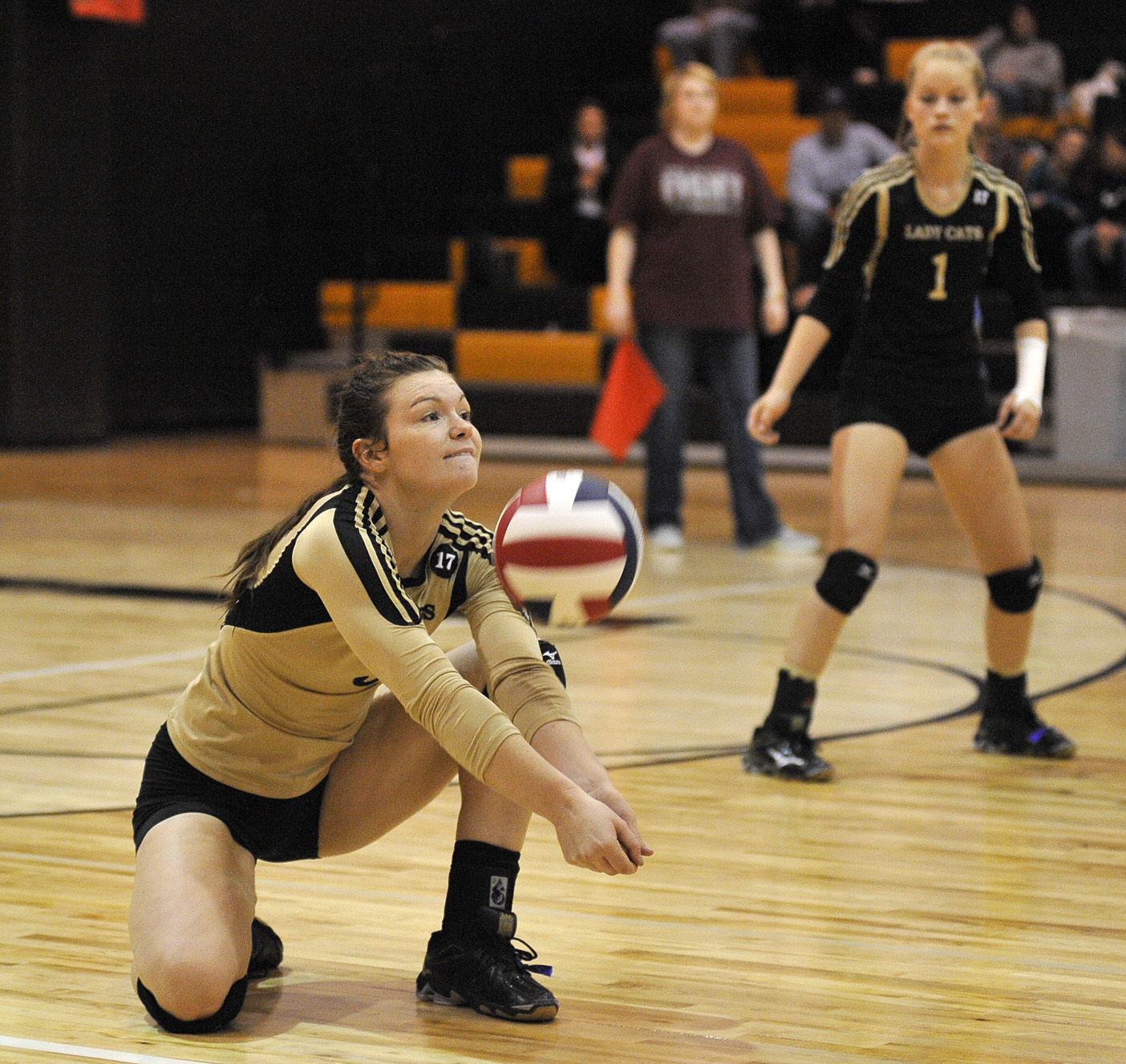 Lady Cat Taylor Bennett gets one of her 10 digs against Bowie Tuesday. Bennett led Henrietta's offensive effort with 17 kills in the four-set win.
