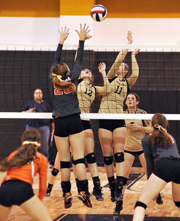 Lady Cats Hollie Thomas and Maddie Brown battle Nocona at the net during Saturday's District 9-3A championship game. Henrietta faces Whitesboro in bi-district Tuesday, Nov. 4.