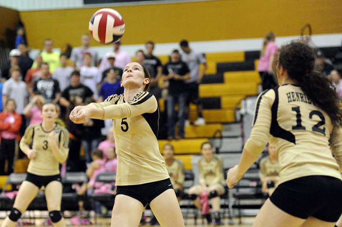 Lady Cat Kenzie Kirk keeps the ball in play during the first set of Henrietta's Tuesday win over Paradise.