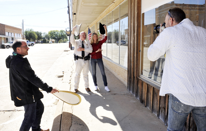 Cameraman Ghir Wikiz photographs Capt. James Tannahill of the Clay County Sheriff's Office and Hege Moe Eriksen, correspondent for the Norwegian Bradcasting Corporation, with assistance from producer Marten Offerdal in downtown Henrietta.