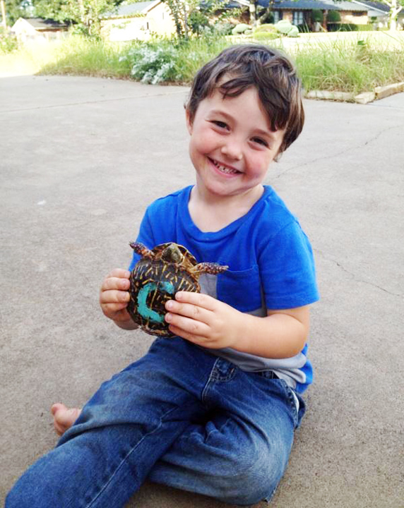 Charlie Wonder, 3, and his traveling turtle.