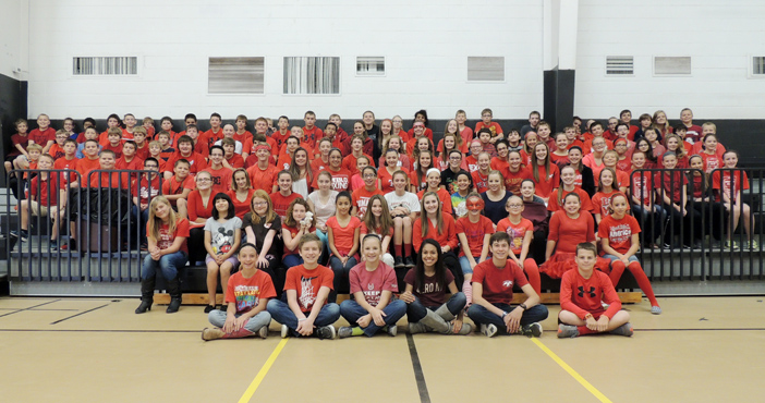 Students at Henrietta Junior High dressed in red Monday to kick off Red Ribbon Week.