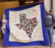 Kylee Erickson of Henrietta displays the Texas-themed quilt she made for the annual Clay County Youth Fair prior to Saturday's auction. Erickson earned reserve grand champion in the intermediate creative arts division.