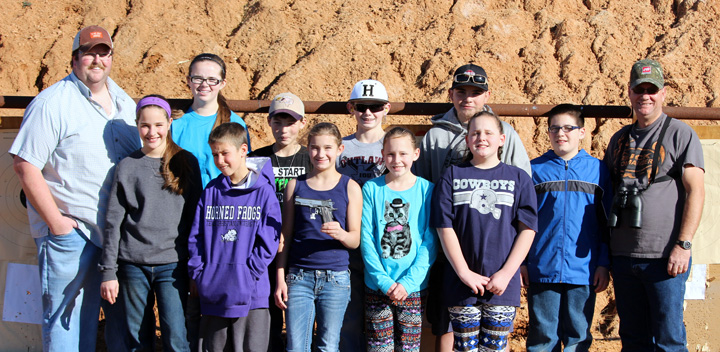 Clay County 4-H Rifle and Pistol team members (front) Leah Scribner, Cole Scribner, Jayla Thomas, Payton Bailey and London Bailey, (back) Coach Boyce Seigler, Regan Seigler, Darrell Burns, Garret Jackson, Jessie Flores, Braiden Bailey and Coach Marshall Thomas are pictured with a Kimber Eclipse Pro II .45 ACP. The team is selling tickets for a drawing to raise funds for the club.