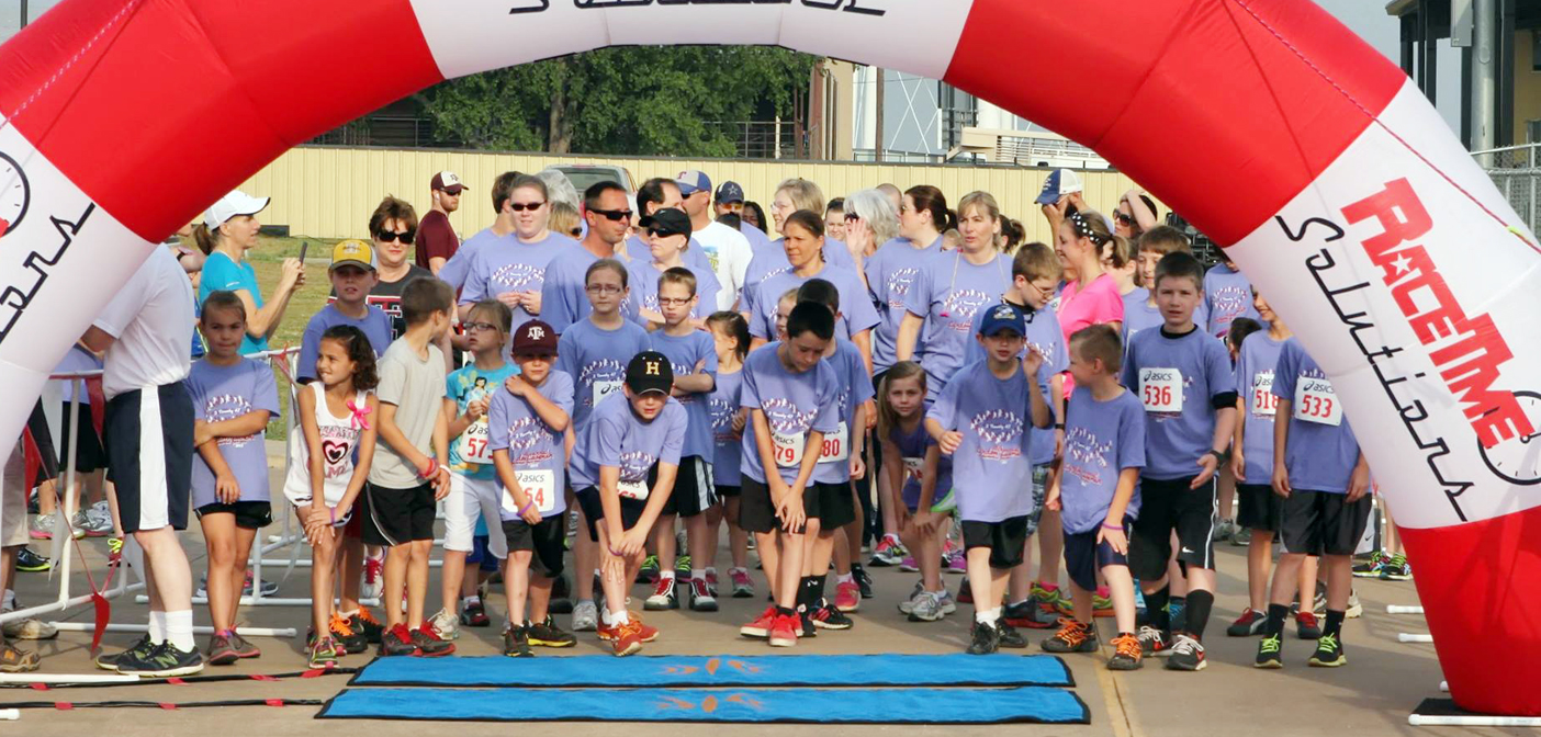 Runners await the start of the one-mile run to kick off the Lyndon Laseman Memorial Fun Run last year. This year's run is set for Saturday, May 16.