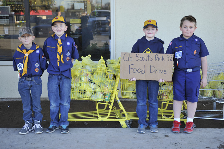 Henrietta Cub Scout Pack 92 collected canned food items for the Clay County Outreach Mission on Friday. Wolves Randall Capps, Ben Kelton, Mason Brooks and Trent Meadows followed the Tiger Cubs in collecting outside the Dollar General store, while the Bears and Webelos collected cans at Diamond Foods.