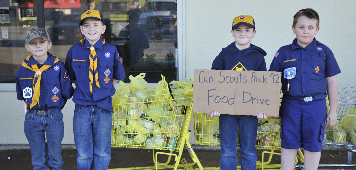 Henrietta Cub Scouts collect cans for Mission Outreach